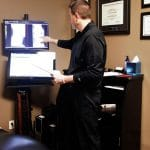 Dr. Kosak pointing to a patients x-ray images