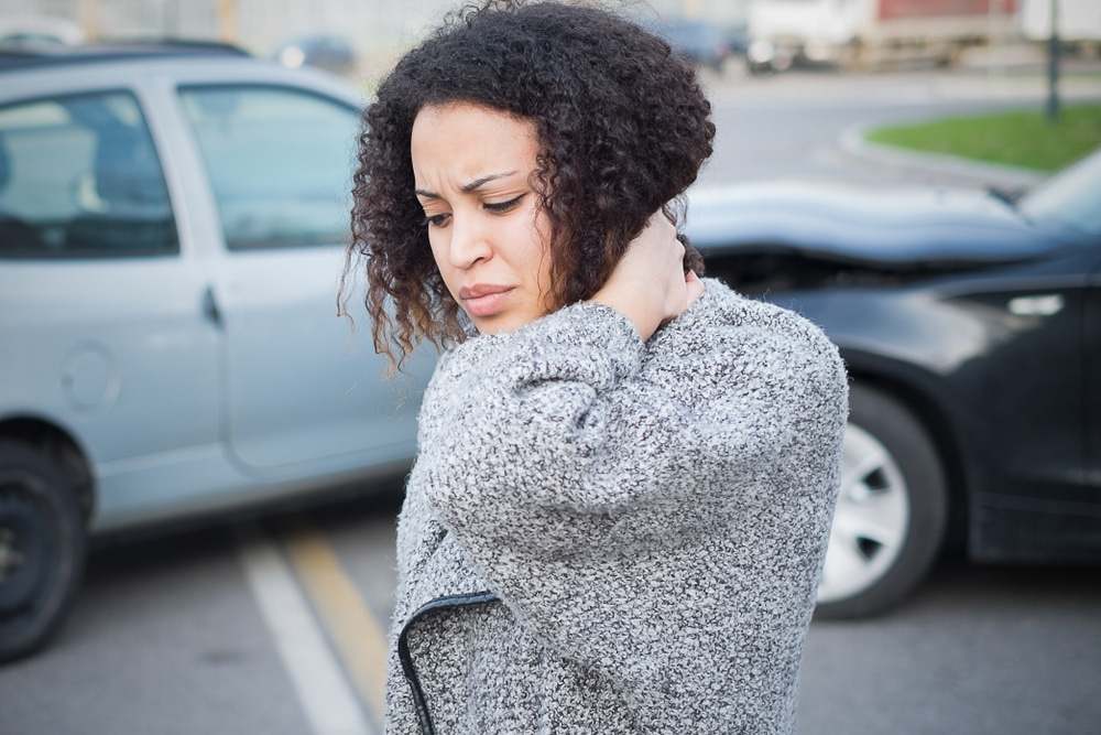 Whiplash Doctor in Omaha treats a patient with neck pain after an auto accident