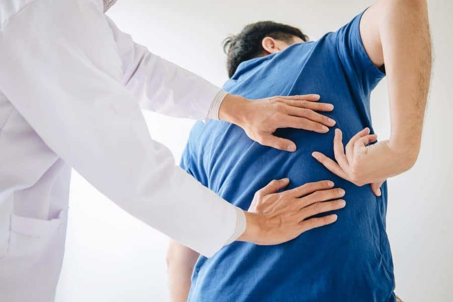 patient with a pinched nerve in his back